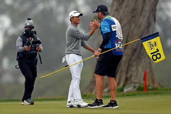 Collin Morikawa celebrates with his caddie after parring 18th hole and winning PGA Championship with a final round of 64 (-6) and -13 for the tournament at TPC Harding Park in San Francisco, Calif., on Sunday, August 9, 2020.