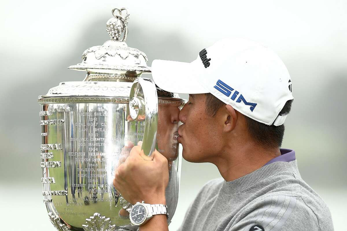 SAN FRANCISCO, CALIFORNIA - AUGUST 09: Collin Morikawa of the United States celebrate by kissing the Wanamaker Trophy after winning during the final round of the 2020 PGA Championship at TPC Harding Park on August 09, 2020 in San Francisco, California. (Photo by Ezra Shaw/Getty Images)