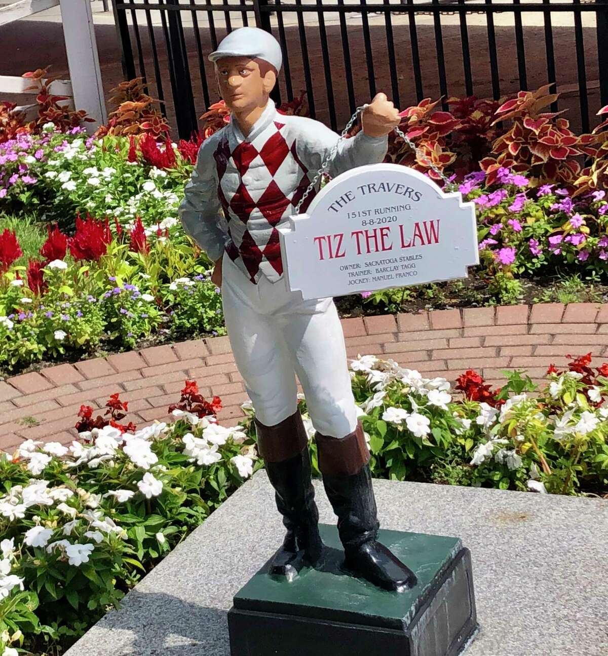 Therea€™s a new jockey ... statue ... in town. It didna€™t take long for the New York Racing Association to honor Travers winner Tiz the Law with his personalized jockey statue in the garden just inside the clubhouse gate. Adorned in the maroon and gray colors of Sackatoga Stable, which owns the New York-bred, the jockey takes over for last yeara€™s Travers winner, Code of Honor, whose jockey statue was adorned in green and yellow. As of Sunday afternoon, the traditional Travers canoe has yet to make its apperance in the infield lake with the new colors, the Sackatoga colors, on it. Soon. a€?