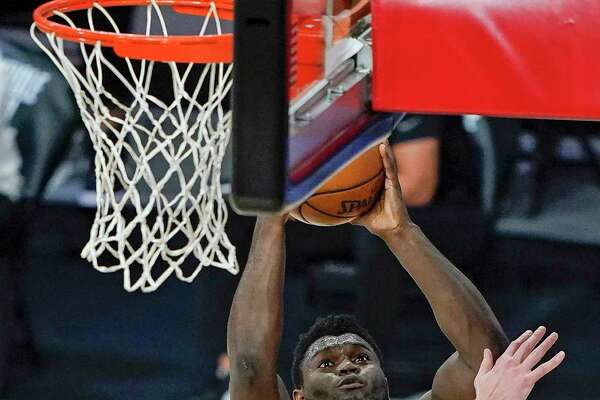 The Spurs' Drew Eubanks (14) took his turn guarding Pelicans star Zion Williamson, who finished just 10 of 20 from the field.
