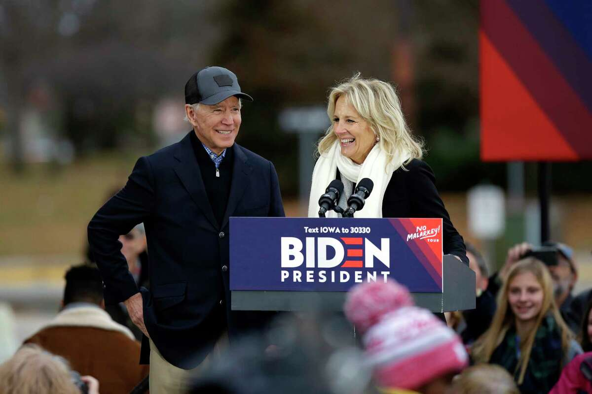 COUNCIL BLUFFS, IA - NOVEMBER 30: Democratic presidential candidate, former Vice President Joe Biden stands with his wife Jill Biden as she introduces him during a campaign event on November 30, 2019 in Council Bluffs, Iowa. Biden, who begins his eight-day bus tour across Iowa on Saturday, once lead the state in the polls but now trails presidential candidates Pete Buttigieg and Elizabeth Warren with just under 3 months until the 2020 Iowa Democratic caucuses. (Photo by Joshua Lott/Getty Images)