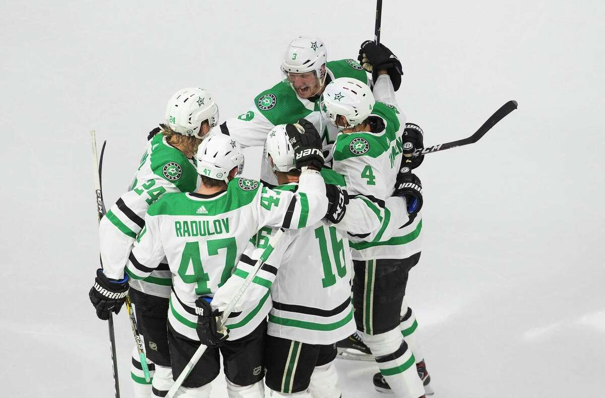 The Dallas Stars celebrate a goal against the St. Louis Blues during the third period of an NHL hockey playoff game Sunday, Aug. 9, 2020, in Edmonton, Alberta. (Jason Franson/The Canadian Press via AP)