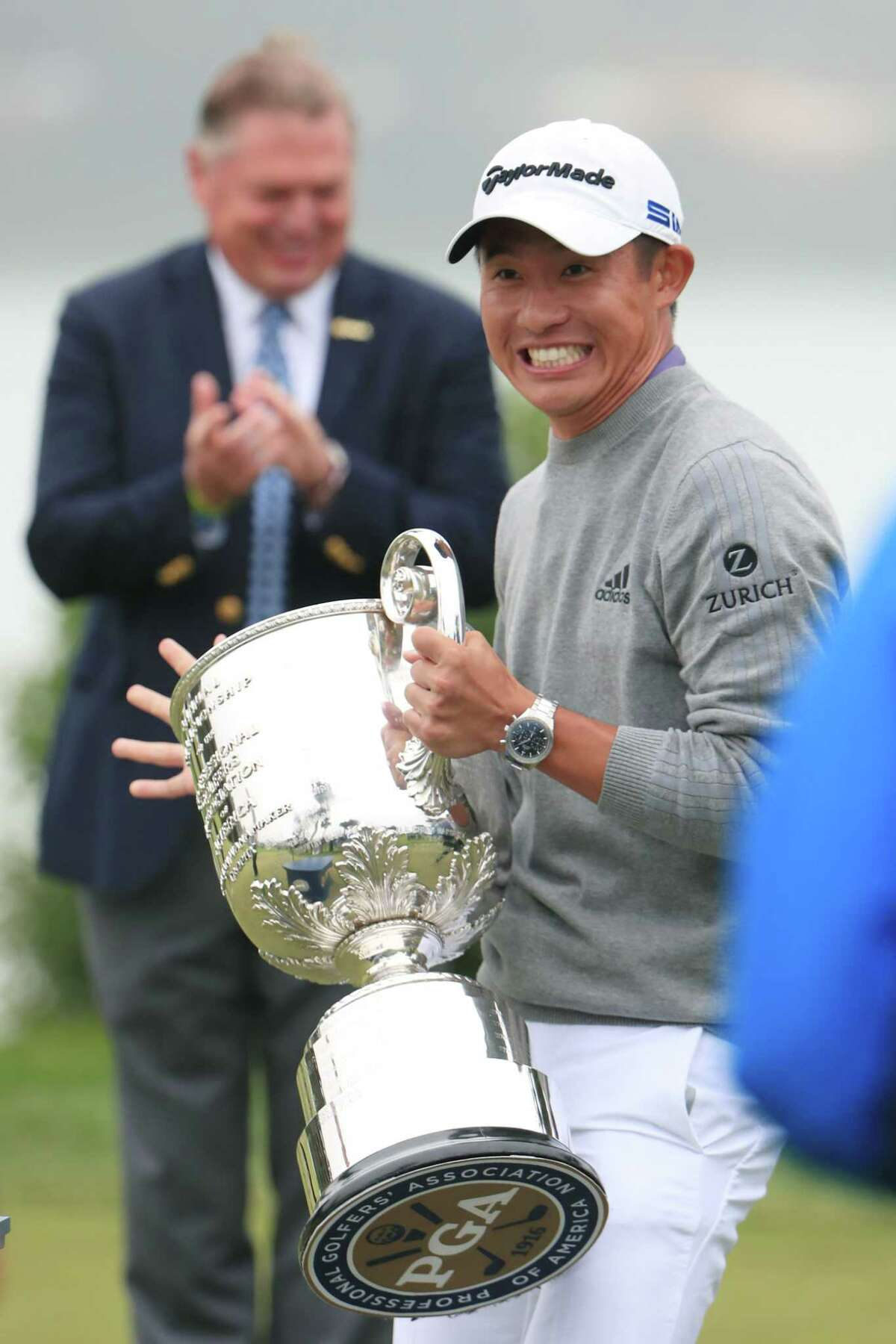 SAN FRANCISCO, CALIFORNIA - AUGUST 09: Collin Morikawa of the United States reacts after the lid to the Wanamaker Trophy fell off during the trophy presentation after the final round of the 2020 PGA Championship at TPC Harding Park on August 09, 2020 in San Francisco, California. (Photo by Tom Pennington/Getty Images)