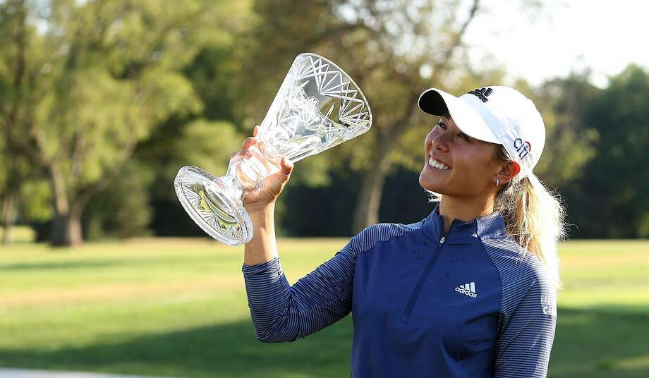 SYLVANIA, OHIO - AUGUST 09: Danielle Kang celebrates with the trophy after winning the Marathon LPGA Classic during the final round at Highland Meadows Golf Club on August 09, 2020 in Sylvania, Ohio. (Photo by Gregory Shamus/Getty Images) Photo: Gregory Shamus / Getty Images