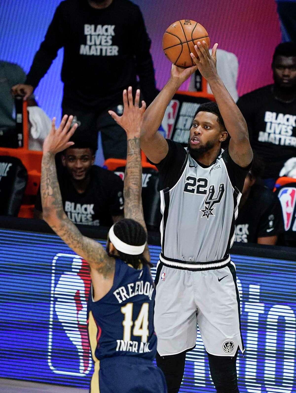 San Antonio Spurs forward Rudy Gay (22) takes a shot over New Orleans Pelicans forward Brandon Ingram (14) during the second half of an NBA basketball game, Sunday, Aug. 9, 2020, in Lake Buena Vista, Fla. (AP Photo/Ashley Landis, Pool)