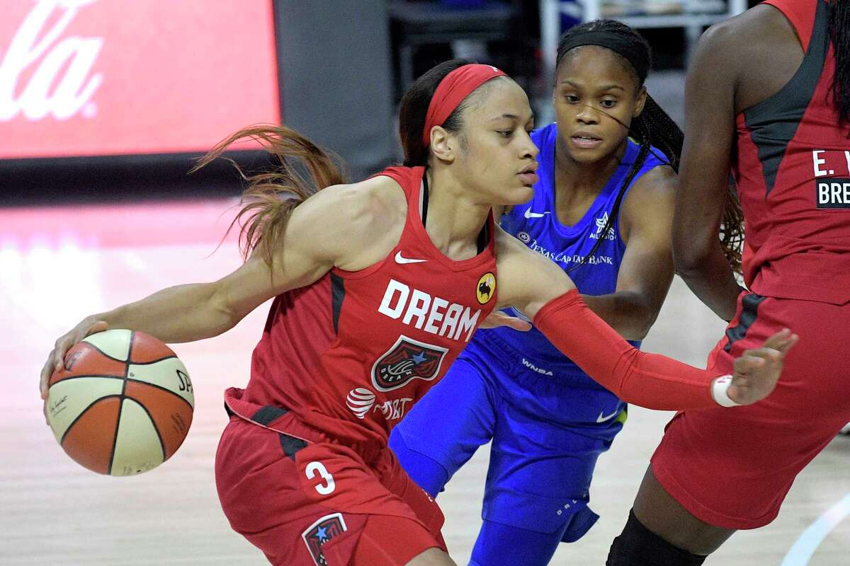 Atlanta Dream guard Chennedy Carter (3) drives past Dallas Wings guard Moriah Jefferson during the first half of a WNBA basketball game Sunday, July 26, 2020, in Bradenton, Fla. (AP Photo/Phelan M. Ebenhack)
