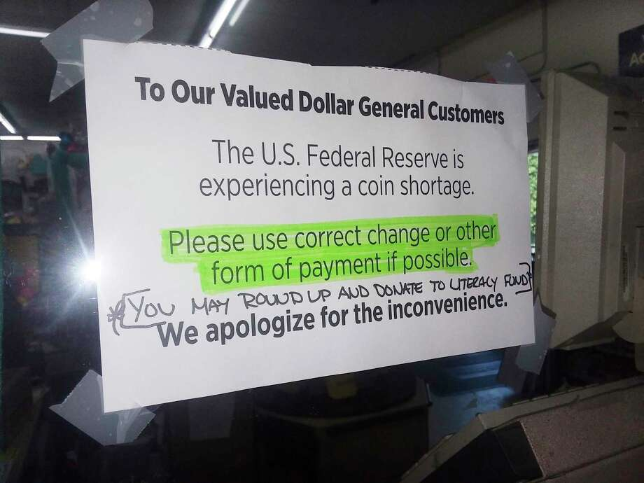 Dollar General in Manistee had a sign posted in July asking customers to use exact change due to a coin shortage. (Michelle Graves/News Advocate)