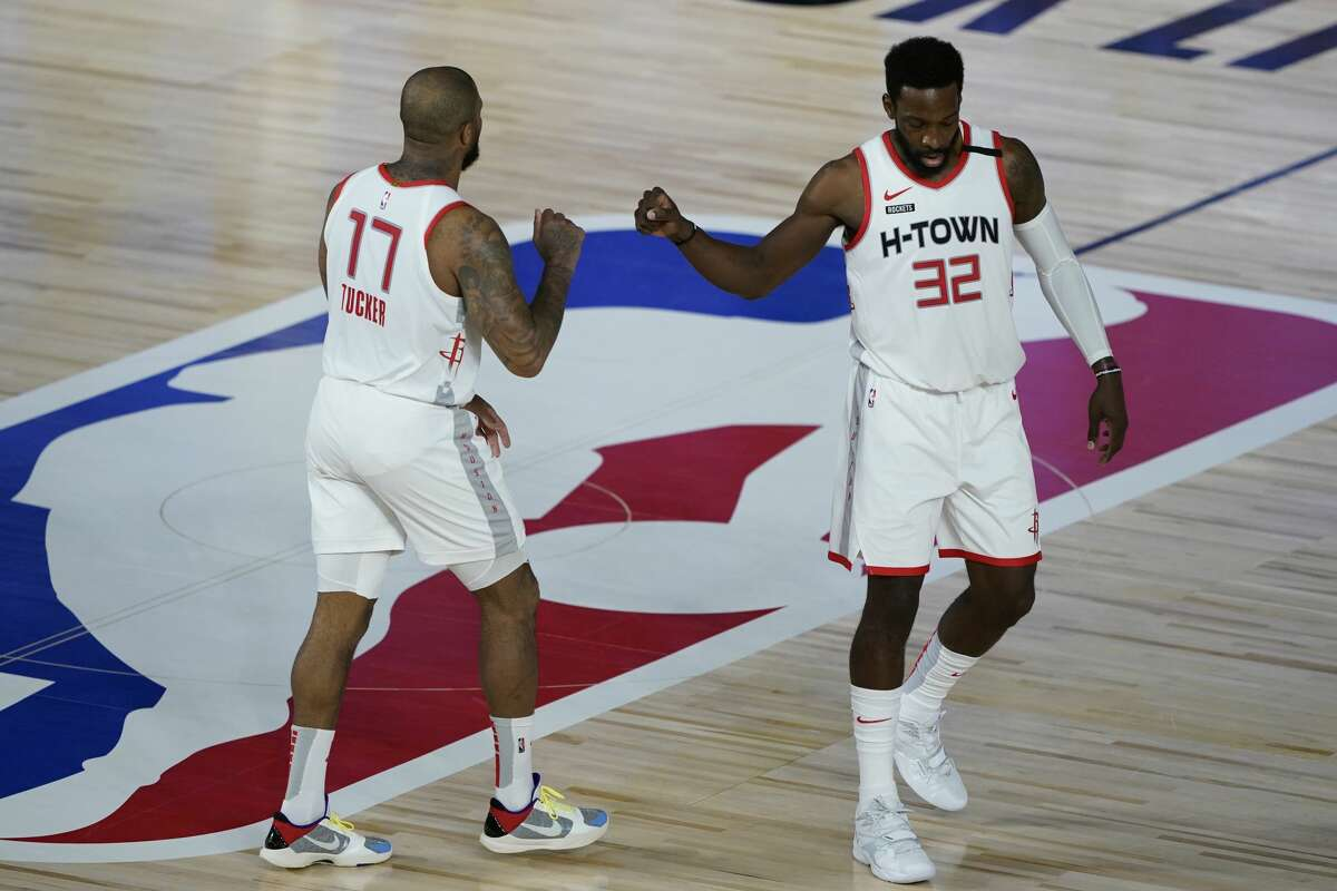 LAKE BUENA VISTA, FLORIDA - AUGUST 09: Jeff Green #32 and P.J. Tucker #17 of the Houston Rockets celebrate after a play against the Sacramento Kings during the second half at HP Field House at ESPN Wide World Of Sports Complex on August 9, 2020 in Lake Buena Vista, Florida. NOTE TO USER: User expressly acknowledges and agrees that, by downloading and or using this photograph, User is consenting to the terms and conditions of the Getty Images License Agreement. (Photo by Ashley Landis-Pool/Getty Images)