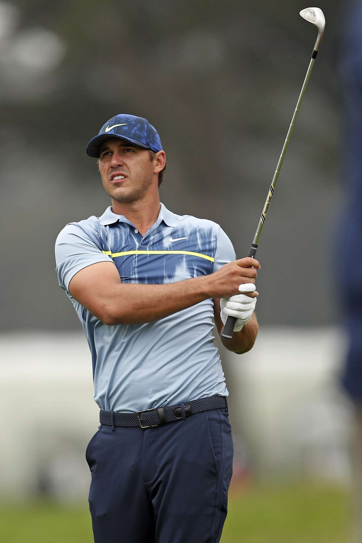 Brooks Koepka watches his approach shot to 1st green during final round of PGA Championship at TPC Harding Park in San Francisco, Calif., on Sunday, August 9, 2020.