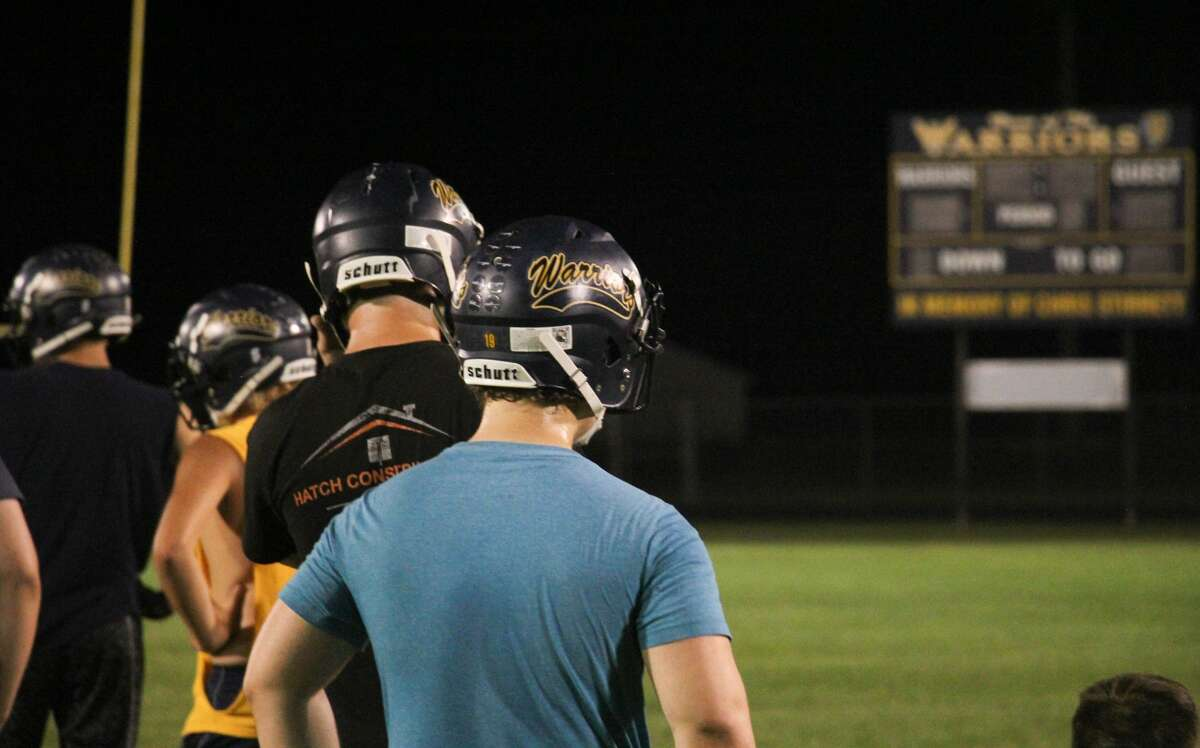 The North Huron Warriors football team gathered in Kinde on Sunday night, Aug. 9, 2020, to hold a practice at the stroke of midnight.