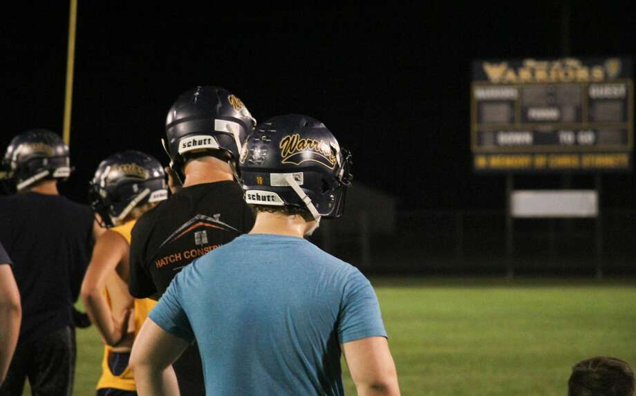 The North Huron Warriors football team gathered in Kinde on Sunday night, Aug. 9, 2020, to hold a practice at the stroke of midnight. Photo: Mark Birdsall/Huron Daily Tribune