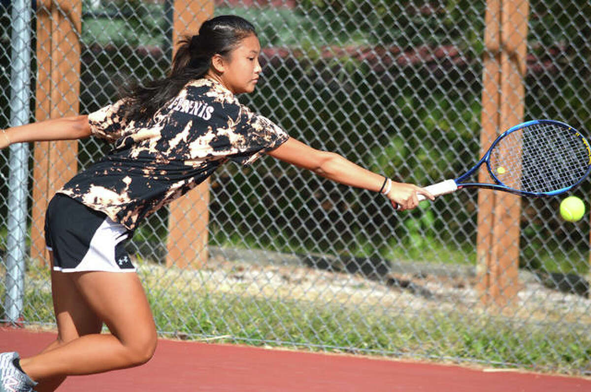 Edwardsville freshman Chloe Koons reaches for a backhand shot on Oct. 19, 2019 during the singles championship match at the Class 2A Edwardsville Sectional.