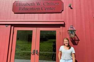 Executive director Lauren Swenson in front of the new Elizabeth W. Chilton Education Center.