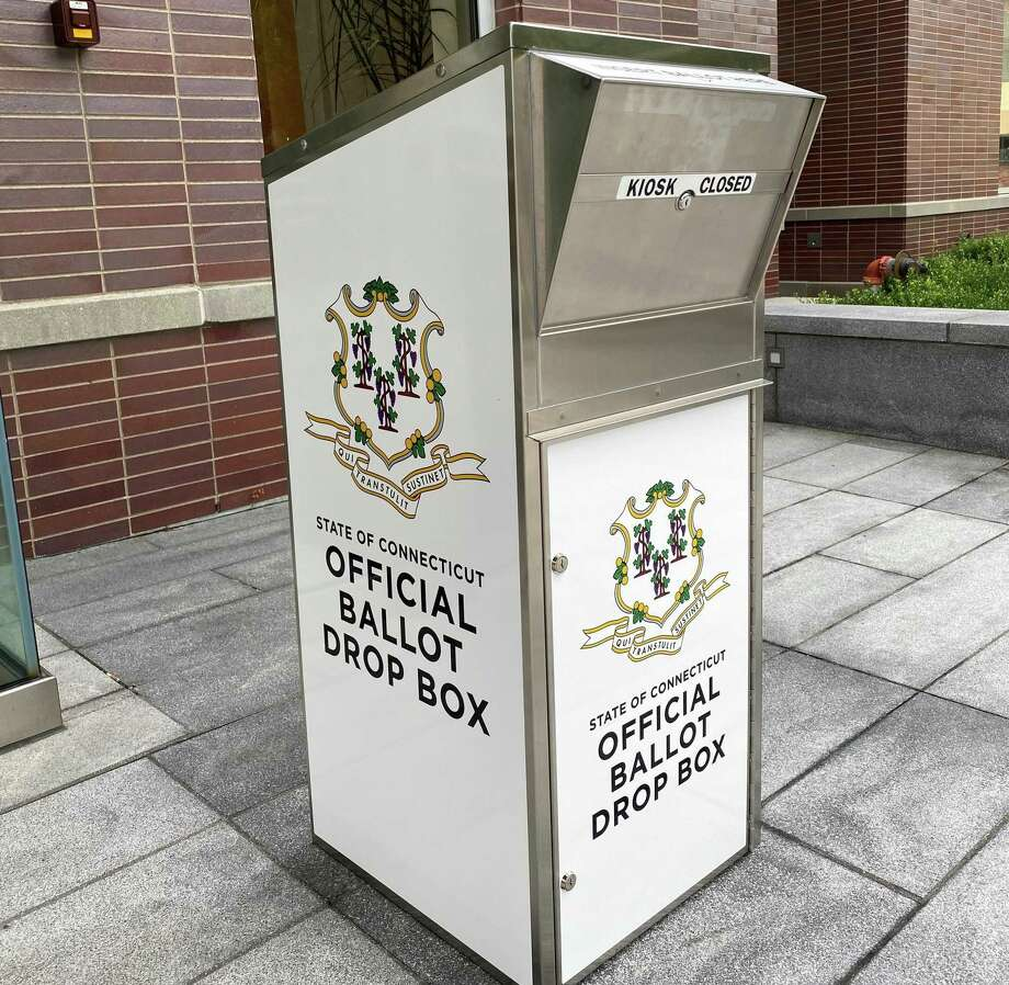 A drop box outside Town Hall awaits applications for absentee ballots for the Nov. 3 election, as well as the completed ballots themselves. Photo: Grace Duffield / Hearst Connecticut Media