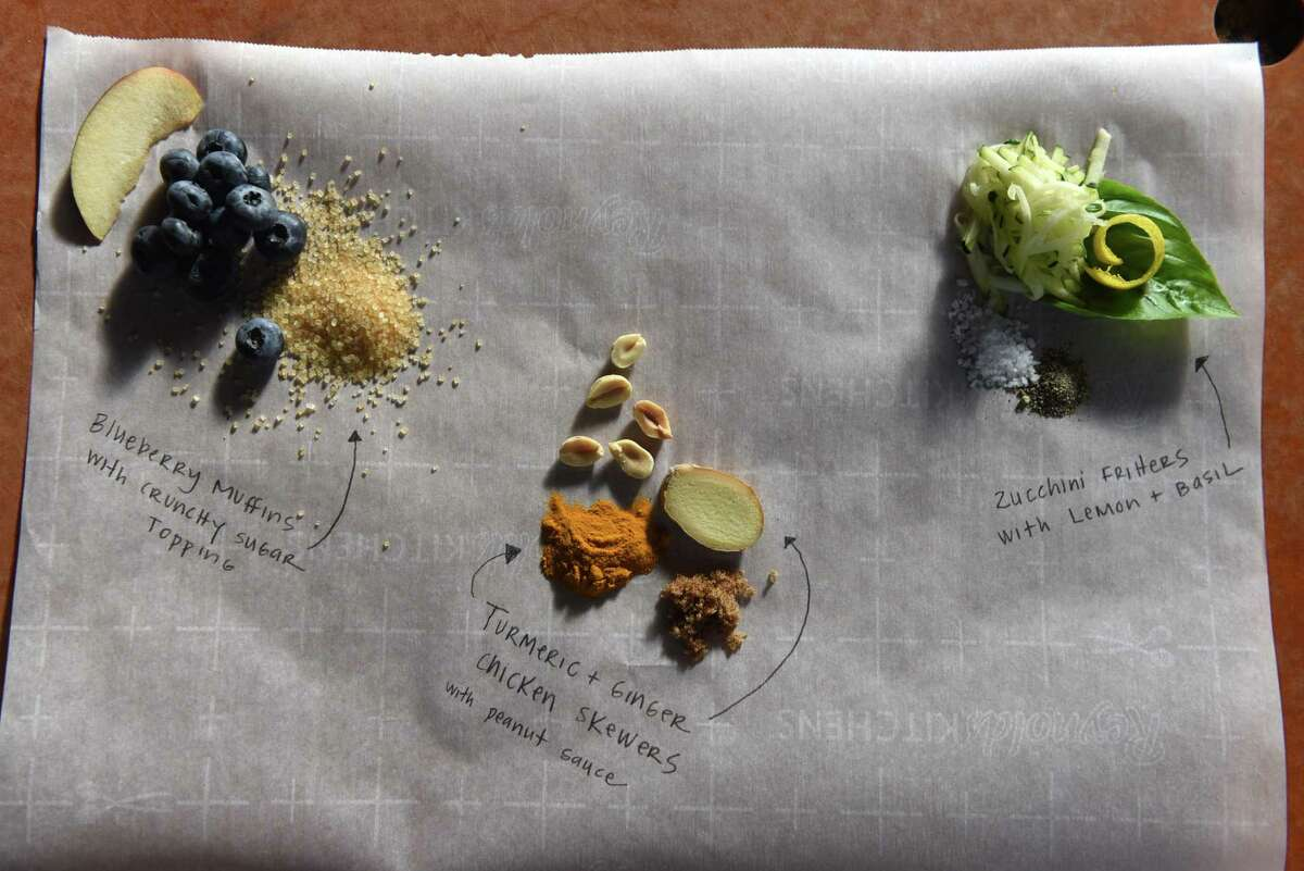 ingredients for Blueberry muffins, left, turmeric and ginger chicken skewers, center, and zucchini fritters, right, from Caroline Barrett on Thursday, July 30, 2020, at her home in Delmar, N.Y. (Will Waldron/Times Union)