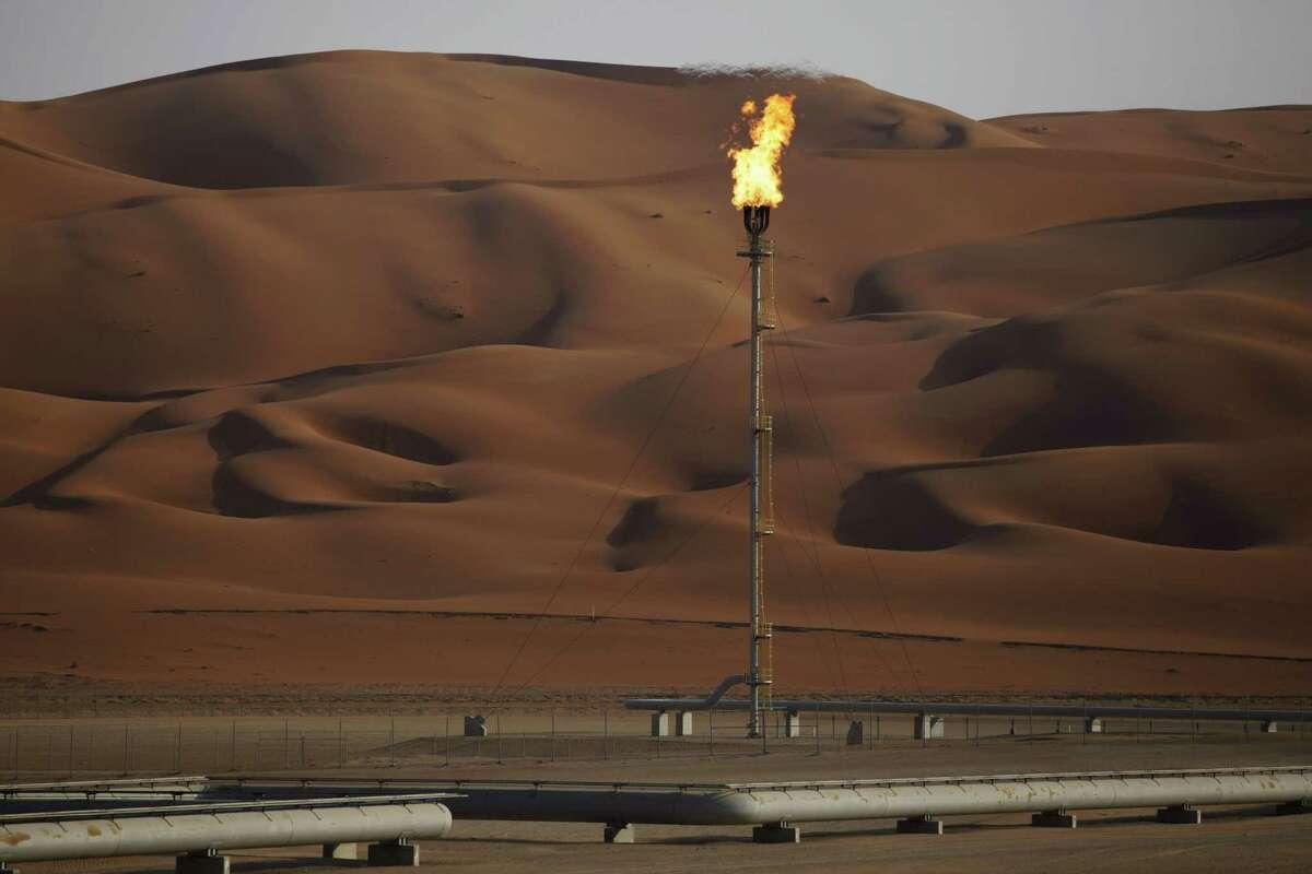Flames burn off at an oil processing facility in Saudi Aramco's oilfield in the Rub' Al-Khali (Empty Quarter) desert in Shaybah, Saudi Arabia, on Oct. 2, 2018.