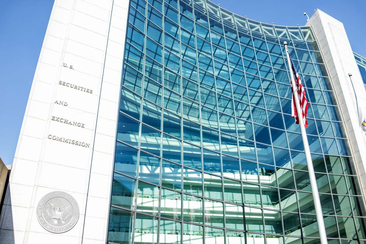 Washington DC, USA - January 13, 2018: US United States Securities and Exchange Commission SEC entrance architecture modern building sign, logo, american flag, looking up sky, glass windows reflection