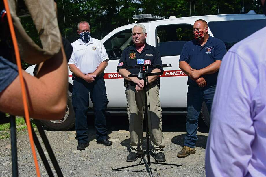 From left, William McGovern, chief of investigations unit at NYS Office of Fire Prevention and Control, Brian LaFlure, Warren County fire coordinator, and Ted Backus, Luzerne-Hadley fire chief, speak to the press about the fire that happened at Rachael Ray's home late Sunday night on Monday, Aug. 10, 2020 in Lake Luzerne, N.Y. (Lori Van Buren/Times Union) Photo: Lori Van Buren, Albany Times Union / 20049747A