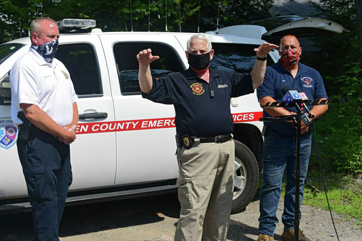 Brian LaFlure, Warren County fire coordinator, explains that the fire that occurred at Rachael Ray's home late Sunday night was contained mainly to the second level of the home Monday, Aug. 10, 2020 in Lake Luzerne, N.Y. William McGovern, chief of investigations unit at NYS Office of Fire Prevention and Control, left, and Ted Backus, Luzerne-Hadley fire chief, right also spoke during the press conference. The celebrity chef's kitchen was not damaged. (Lori Van Buren/Times Union)