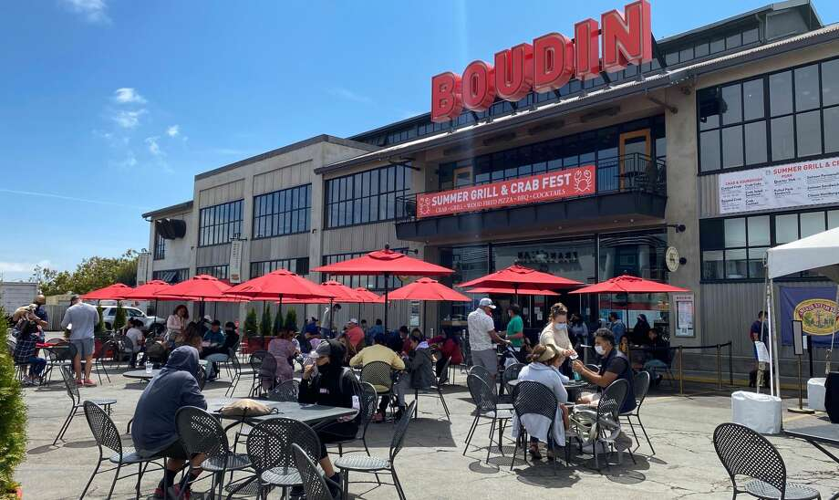 People enjoy lunch in a crowded outdoor area of a Pier 45 restaurant in San Francisco, California on August 2, 2020 amid the coronavirus pandemic. Photo: DANIEL SLIM/AFP Via Getty Images
