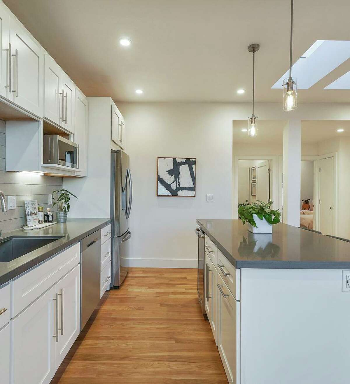 A pair of skylights help illuminate a kitchen anchored by a bar island at 363 Bright St. in Ingleside Heights.