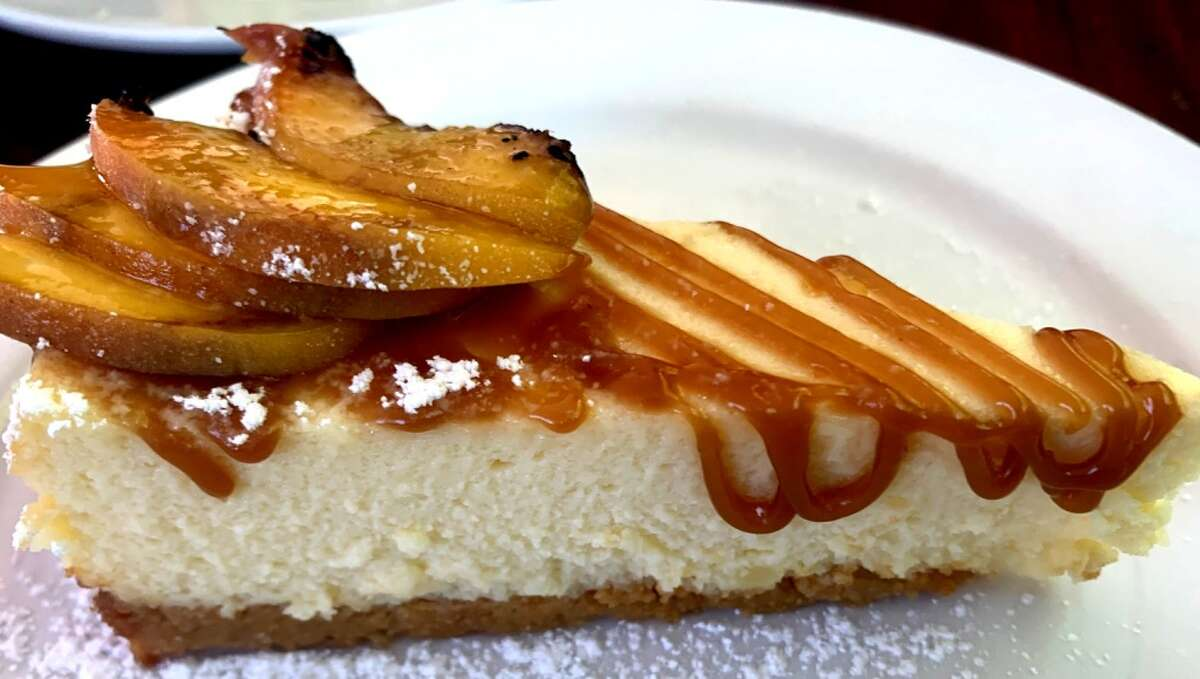 Sweet Corn Cheesecake: Grilled peaches, bourbon salted caramel at New World Bistro Bar.