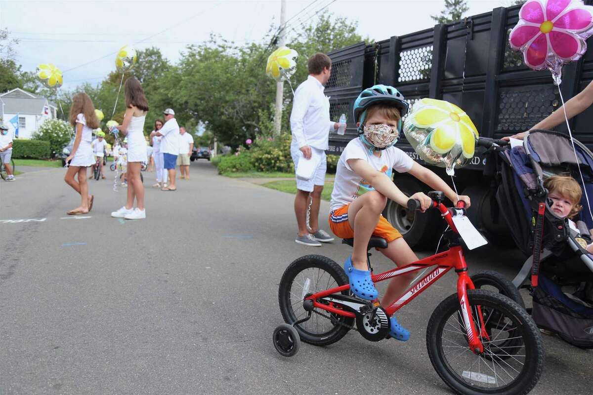 Oliver Jones, 4, of Fairfield, takes part in the celebration for the life of Deanna Herlihy on Saturday, Aug. 8, 2020, in Fairfield, Conn.