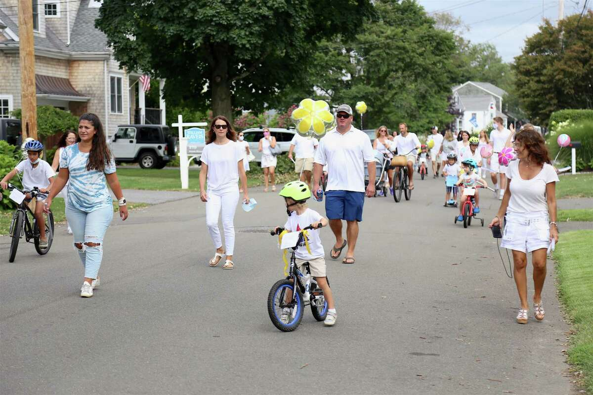 Most wore white in the parade for the celebration for the life of Deanna Herlihy on Saturday, Aug. 8, 2020, in Fairfield, Conn.