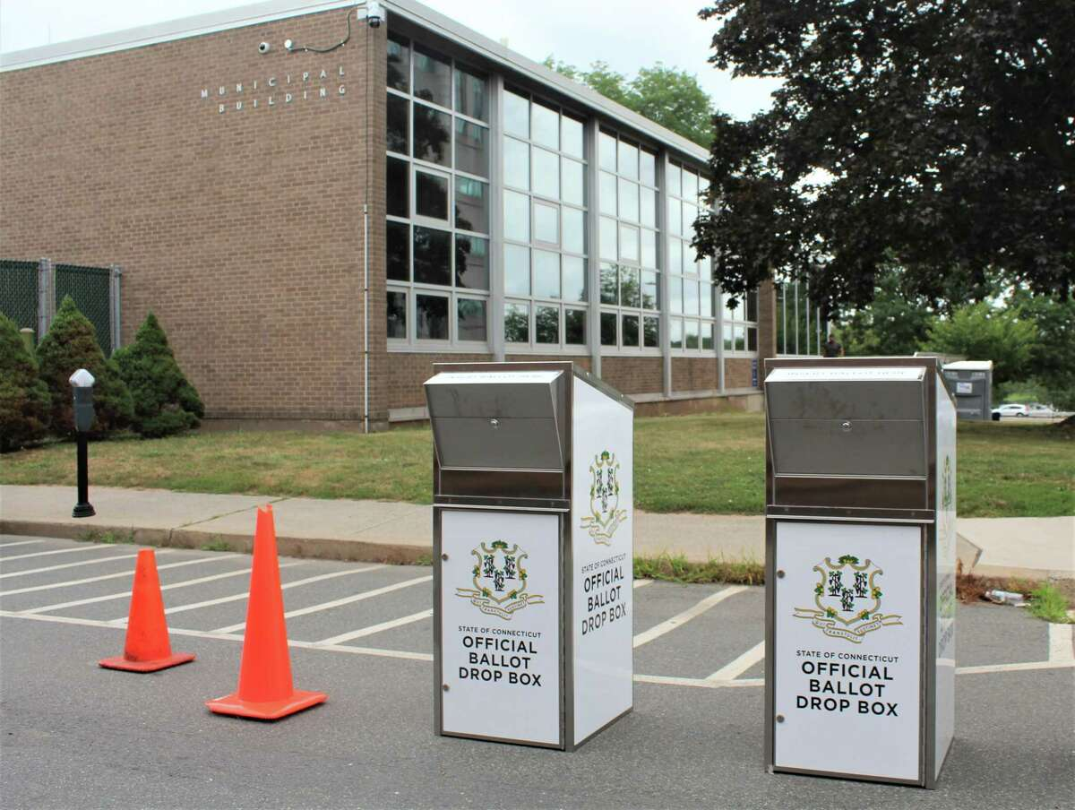 Two secure ballot boxes are positioned outside Middletown City Hall, off Court Street, so absentee voters can cast their votes for the upcoming election from their cars or on foot.
