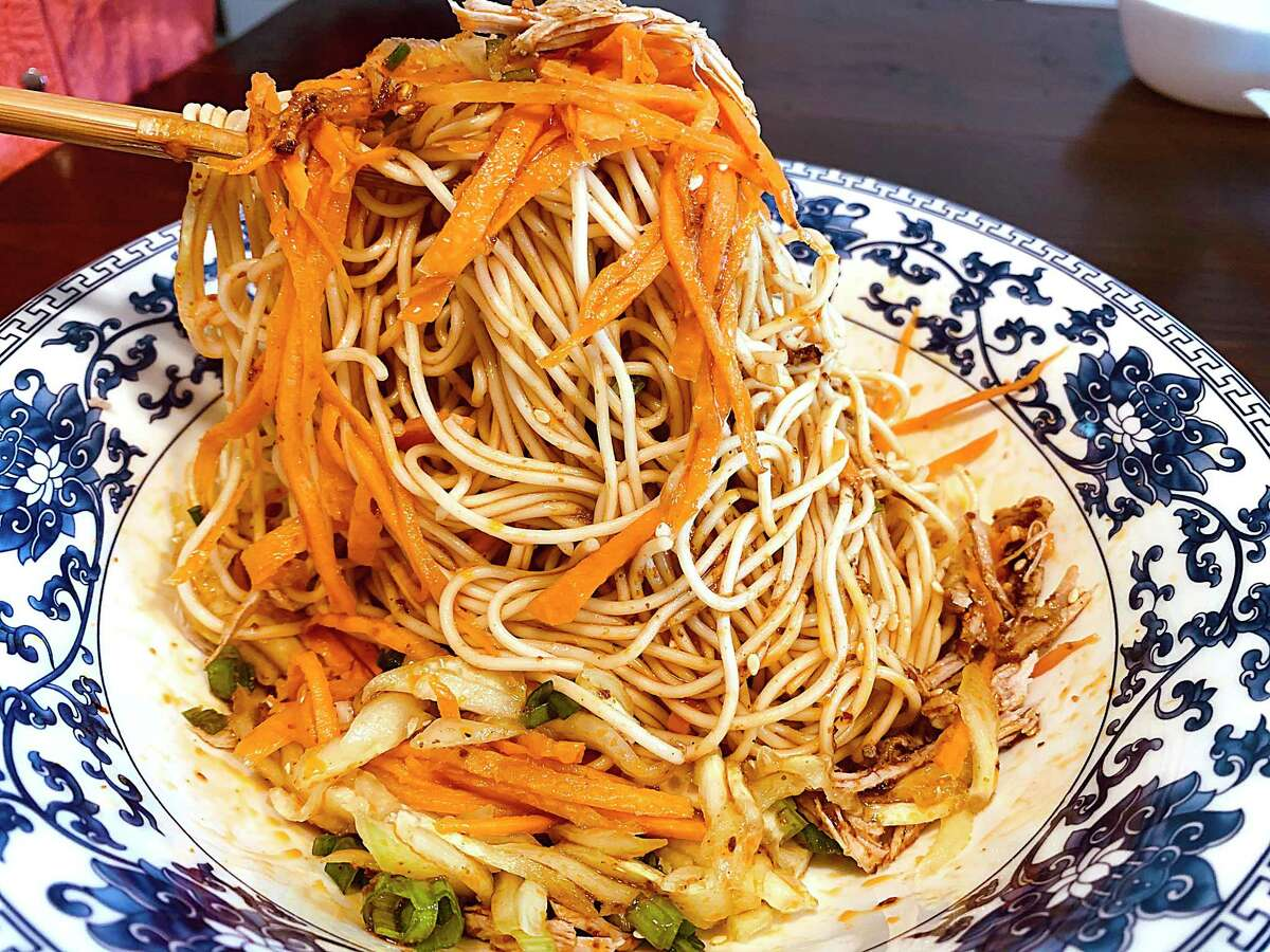 Garlicky cold noodles are a specialty dish at Shifu Noodle, a new Sichuan-style Chinese noodle house at McCreless Market on the Southeast Side.