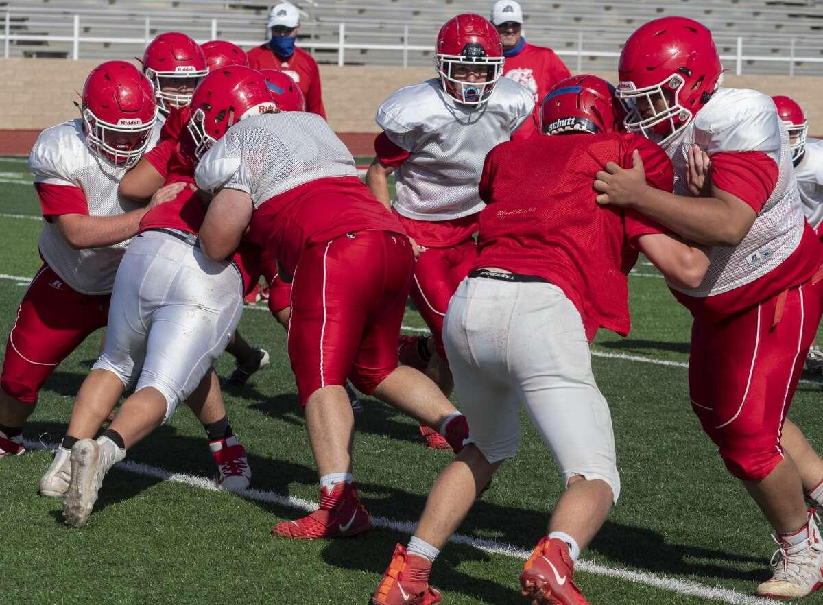 Coahoma football players run drills 08/10/2020 during practice. Tim Fischer/Reporter-Telegram