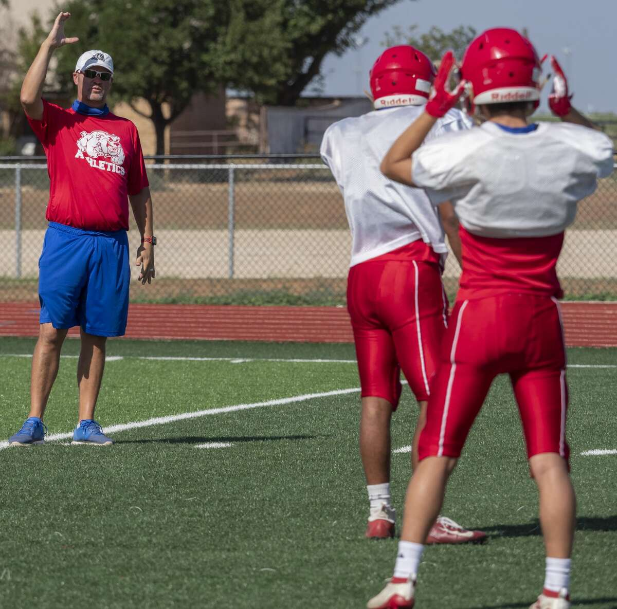 Coahoma coach Chris Joslin signals plays 08/10/2020 during practice. Tim Fischer/Reporter-Telegram
