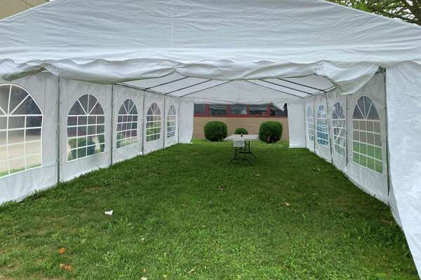 Presently, this tent, located near the front door of the New Canaan High School, is being used as a charging station and internet access for people out of power following Tropical Storm Isaias' reign on the town last week, but it is expected to be used as a classroom in the fall.
