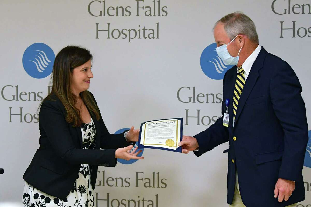 U.S Representative Elise Stefanik presents a Congressional Record to Bill Powers, chair of Board of Governors, at Glens Falls Hospital on Monday, Aug. 10, 2020 in Glens Falls, N.Y. The award was honoring the frontline employees of the Glens Falls Hospital for their heroic work thoughout the COVID-19 pandemic. (Lori Van Buren/Times Union)
