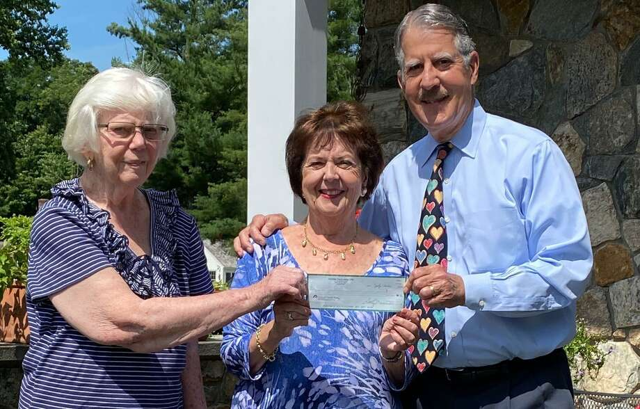 Stay at Home in Wilton receives a donation from the Wilton Woman's Club. From left, executive coordinator Janet Johnson, president Sally Maraventano Kirmser, and board member Ralph Kirmser. Aug. 2020 Photo: Contributed Photo / Wilton Woman's Club / Wilton Bulletin Contributed