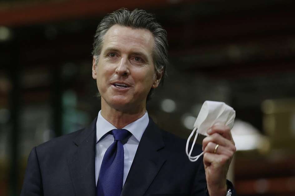 FILE - California Gov. Gavin Newsom displays a face mask as he urges people to wear them to fight the spread of the coronavirus during a news conference in Rancho Cordova, Calif., Friday, June 26, 2020. Gov. Newsom is cautiously optimistic that California is getting a grip on a resurgence of the coronavirus. But he warned Monday, Aug. 3, 2020, that the state is a long way from reopening some of the businesses it shuttered for a second time last month when new cases, hospitalizations, and deaths began surging. The seven-day average and rate of positive tests are both down, as are hospitalizations and intensive care cases. (AP Photo/Rich Pedroncelli, Pool, File)
