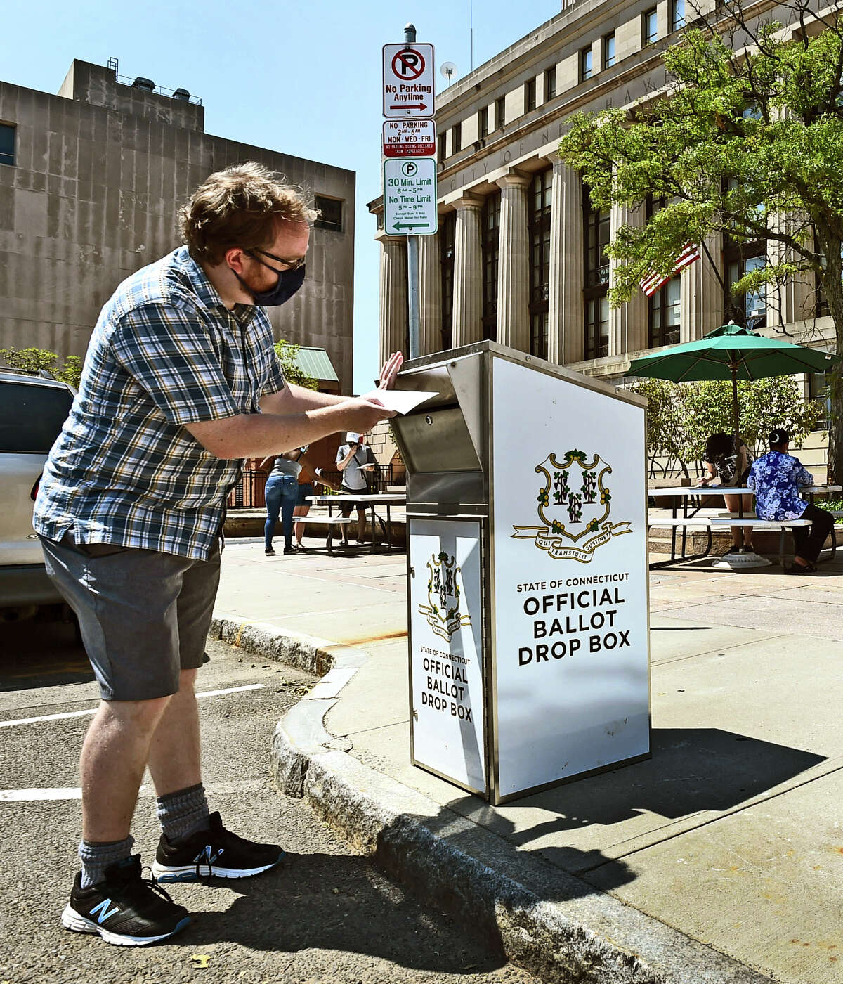 New Haven, Connecticut - Monday, August 10, 2020: Edward Dumar drops his absentee ballot vote Monday into the Official Ballot Drop Box in front of the Hall of Records at 200 Orange St. in New Haven. The New Haven City Clerk's office has set up tables where people can apply for an absentee ballot and then vote by putting it into the drop box. The Hall of Records is still officially closed. Voters have up to 8 p.m. on Tuesday to put the ballot in the drop box.
