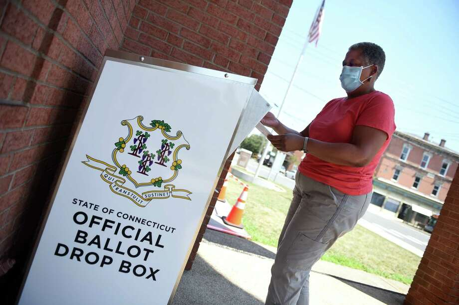 Karyn Stokes drops off her absentee ballot at an Official Ballot Drop Box in front of West Haven City Hall on August 10, 2020. Photo: Arnold Gold, Hearst Connecticut Media / New Haven Register