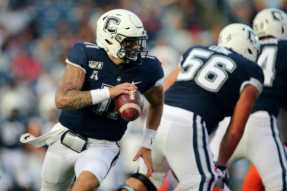 Connecticut quarterback Jack Zergiotis looks to pass in a game against Illinois last year. UConn has canceled its 2020-2021 football season. Photo: Associated Press / Copyright 2019 The Associated Press. All rights reserved.