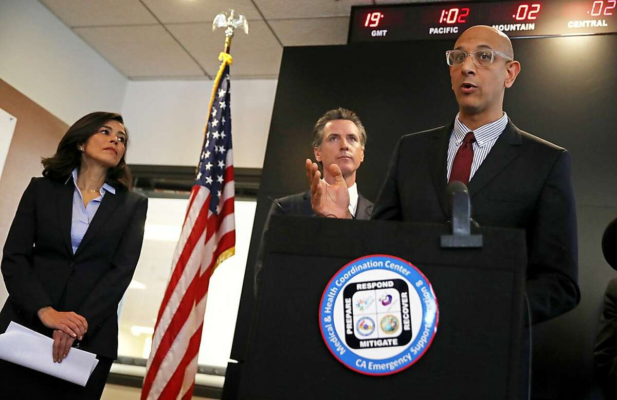 SACRAMENTO, CALIFORNIA - FEBRUARY 27: California Health and Human Services Agency Secretary Dr. Mark Ghaly (R) speaks speaks during a news conference as California Gov. Gavin Newsom (C) and California Department of Public Health Director and State Health