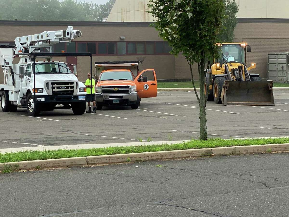 New Canaan Public Works workers waited for more Eversource trucks to show up in summer 2020 so they could clean up damage from Tropical Storm Isaias, which was brief, but very damaging.