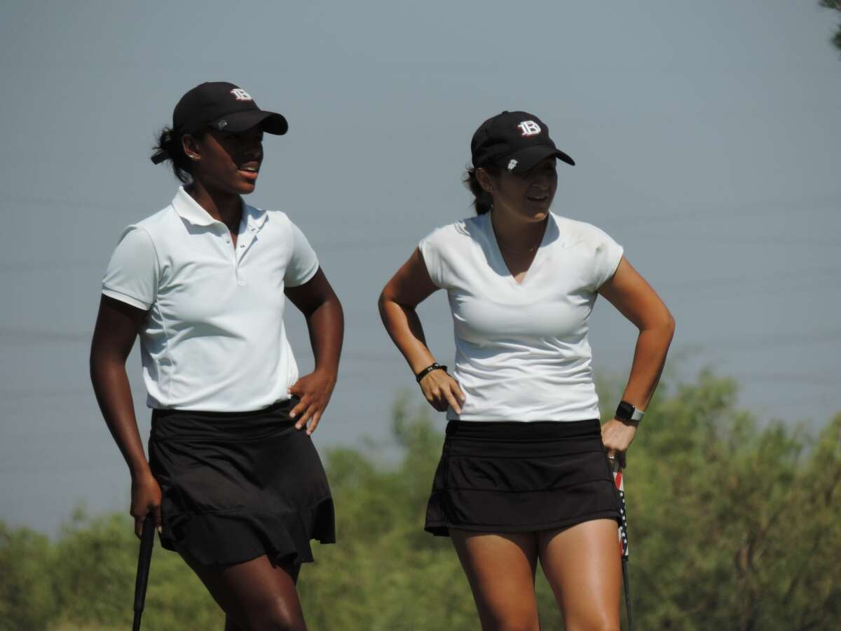 Midland High grad Faith DeLaGarza, right, and her Dallas Baptist teammate Amari Smith look on at hole No. 18 during the Women's Four-Ball tournament, Aug. 10 at Midland Country Club.