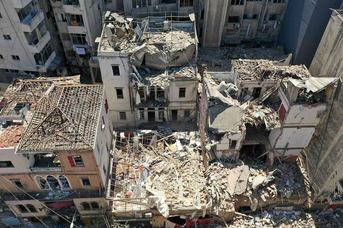 An aerial view shows damaged buildings in Beirut's neighbourhood of Gemayzeh, days after a huge chemical explosion hit the nearby port, devastating large parts of the Lebanese capital and claiming over 150 lives. (Photo by - / AFP) (Photo by -/AFP via Getty Images)