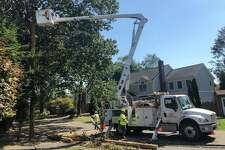 A crew from South Carolina-based Sumter Utilities works to restore electricity to Meadow Court in Fairfield Aug. 10, 2020 nearly a week after Tropical Storm Isaias knocked out power to the area.