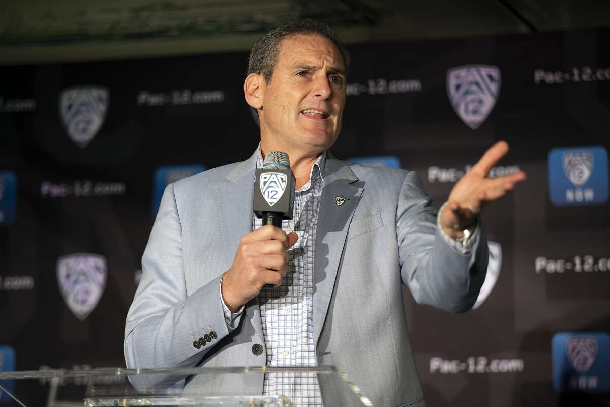 Commissioner Larry Scott speaks during the Pac-12 NCAA college basketball media day in San Francisco. After the Power Five conference commissioners met Sunday, Aug. 9, 2020, to discuss mounting concern about whether a college football season can be played in a pandemic, players took to social media to urge leaders to let them play. (AP Photo/D. Ross Cameron, File)