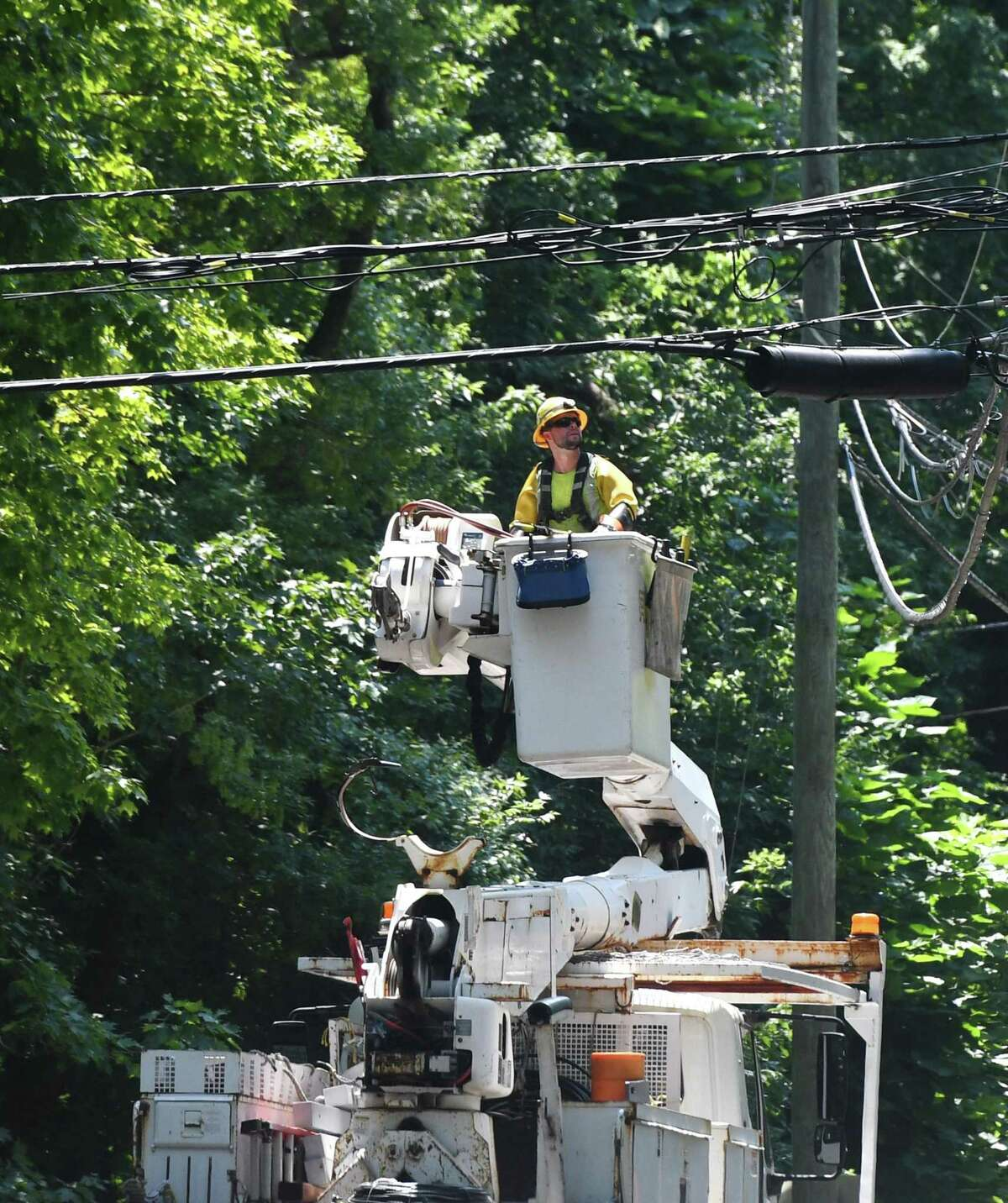 Crews repair powerlines Doubling Road six days after Tropical Storm Isaias hit Greenwich, Conn. Monday, Aug. 10, 2020. Many Eversource customers still remain without power as crews continue scrambling to repair downed powerlines and clean up fallen trees.