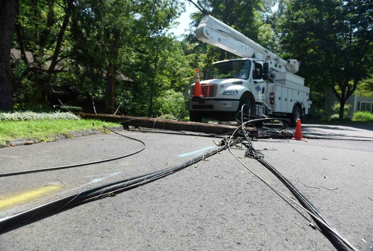 Crews repair powerlines on Angelus Drive in Glenville downed six days after Tropical Storm Isaias hit Greenwich, Conn. Monday, Aug. 10, 2020.