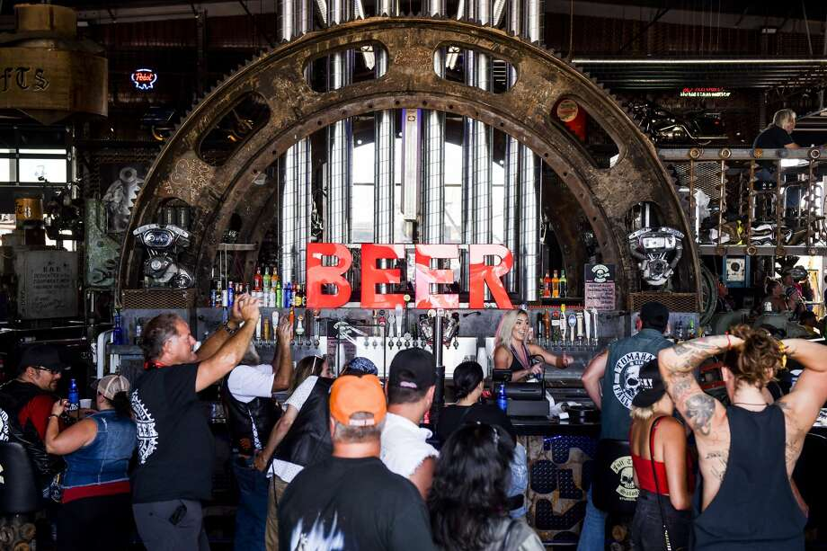 People watch a concert at the Full Throttle Saloon during the 80th Annual Sturgis Motorcycle Rally in Sturgis, South Dakota on August 9, 2020. While the rally usually attracts around 500,000 people, officials estimate that more than 250,000 people may still show up to this year's festival despite the coronavirus pandemic. (Photo by Michael Ciaglo/Getty Images) Photo: Michael Ciaglo/Getty Images / 2020 Getty Images