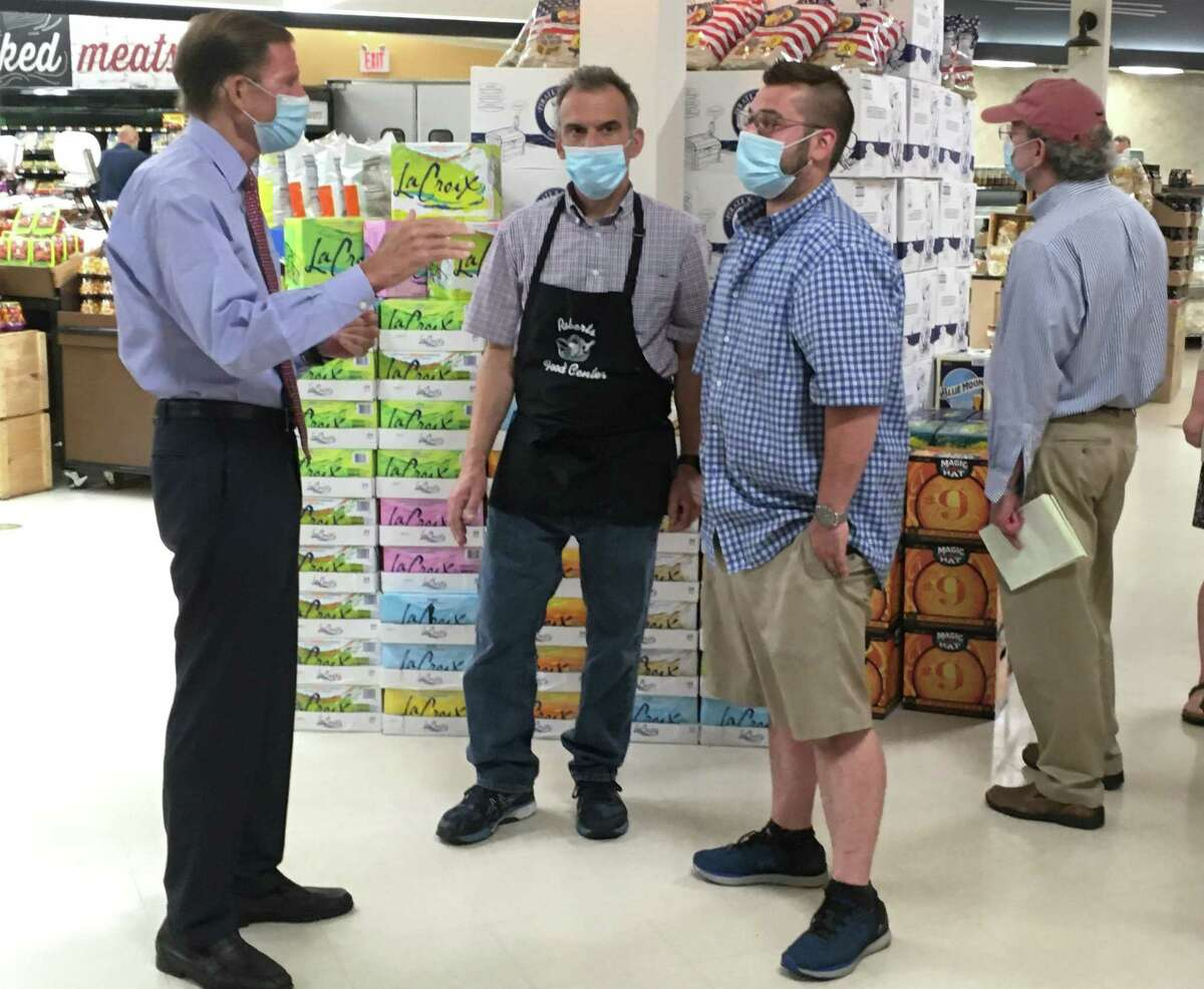 U.S. Sen. Richard Blumenthal, D-Conn., left, tours Robert's Food Center in Madison Aug. 10. Speaking with Blumenthal are co-owners Bob Fusco Jr., center, and Zach Fusco.