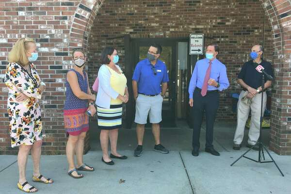 U.S. Sen. Richard Blumenthal, D-Conn., second from right, speaks with state and local officials Aug. 10, 2020, at Robert's Food Center in Madison, which suffered a five-day outage after Hurricane Isaias. Also pictured, from left, are state Rep. Noreen Kokoruda, R-Madison, state Sen. Christine Cohen, D-Guilford, Madison First Selectwoman Peggy Lyons and Madison Selectmen Scott Murphy and Al Goldberg.